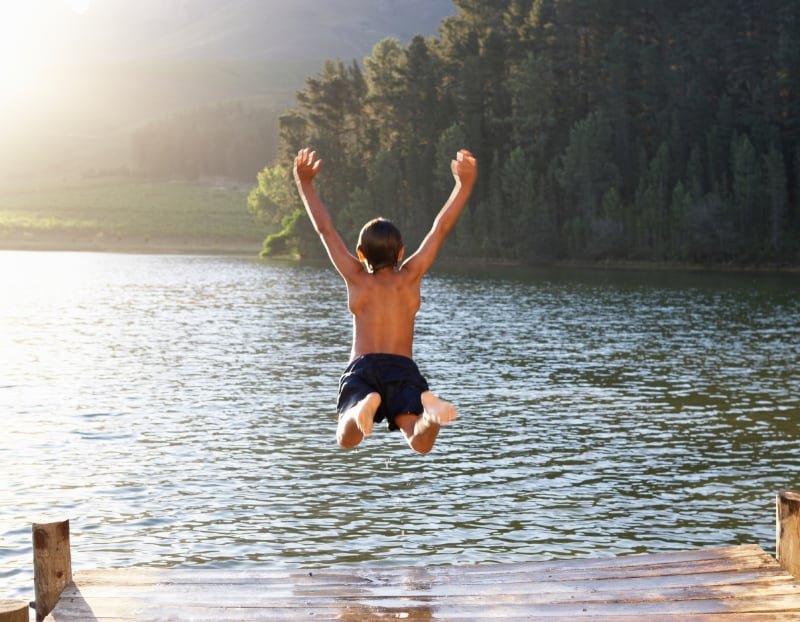 kid jumping into river